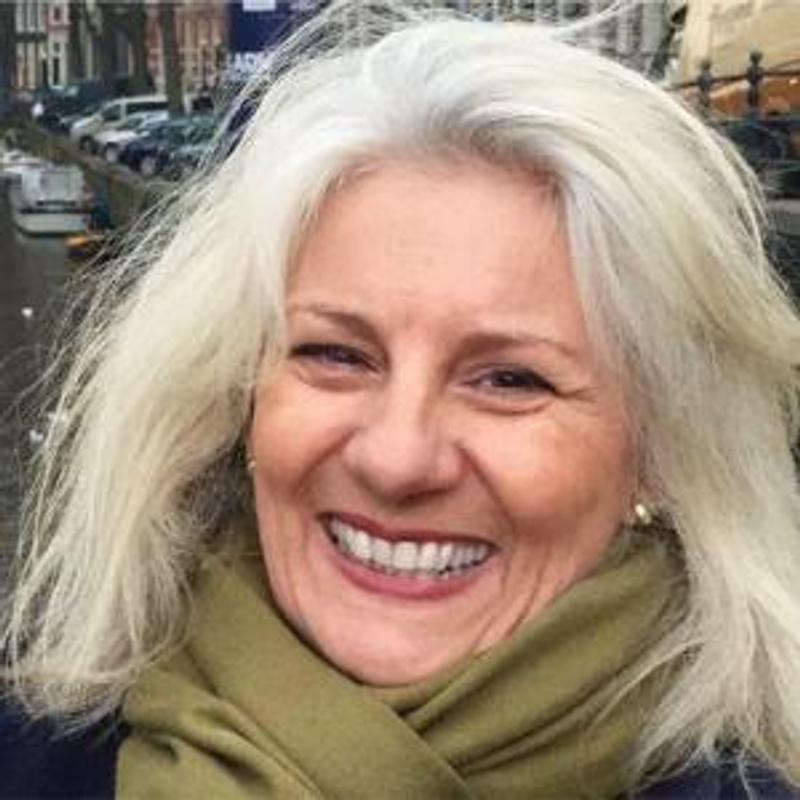 head shot smiling woman with fair hair