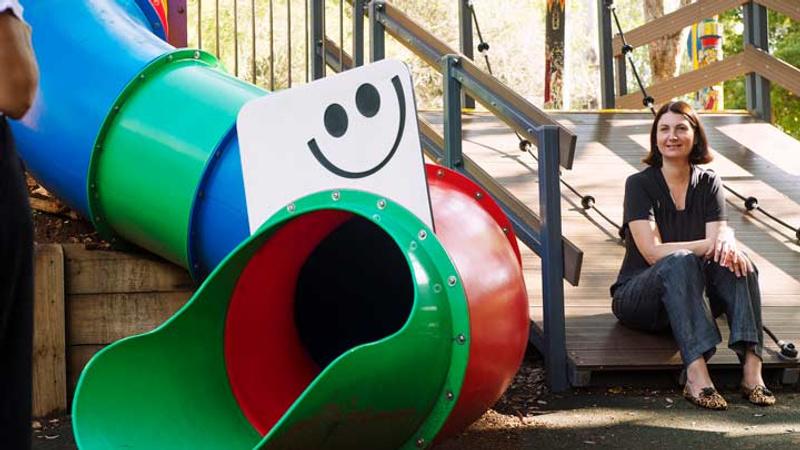 Woman sitting in  children's playground