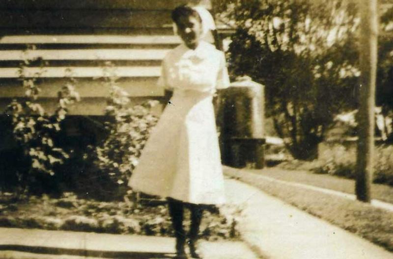Old photo of Aboriginal woman in nurse uniform