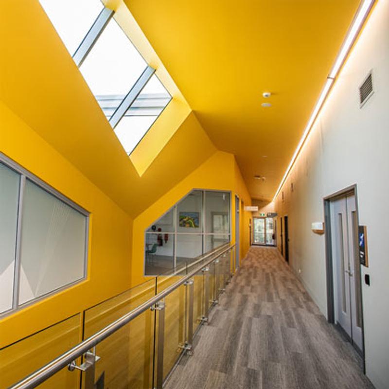 Hallway with glass side rail