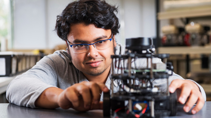 Male engineering student working on a model