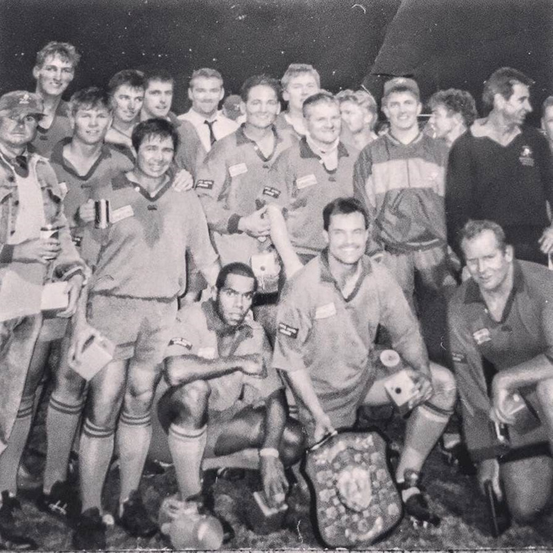 Black and white images of rugby union players with trophy