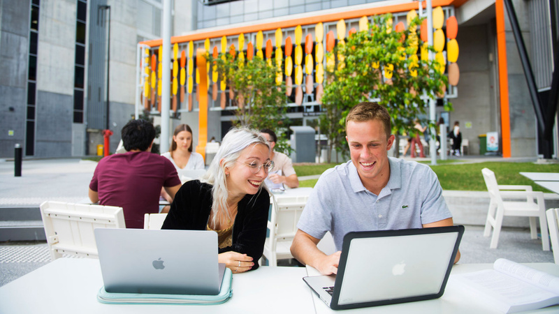 Students seated with laptops at Gold Coast campus