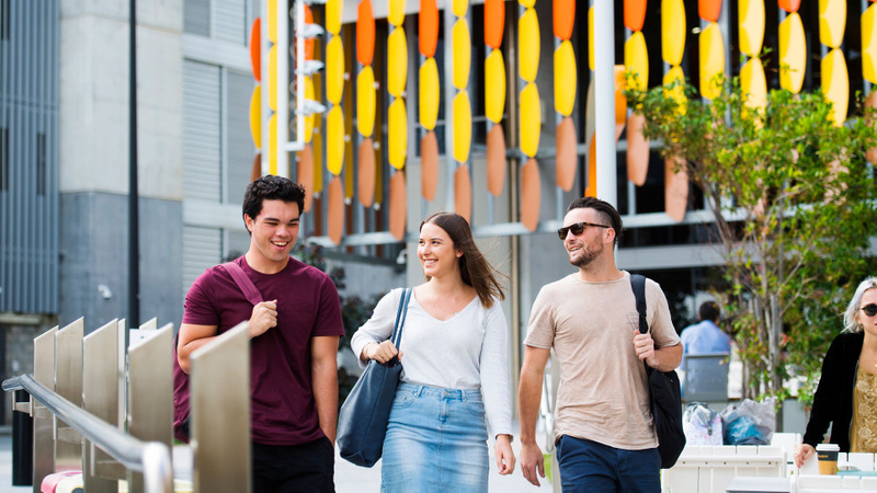 Three students outdoors at the Gold Coast campus