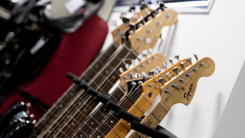 Row of guitar necks studio